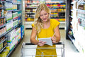Blonde woman checking list Royalty Free Stock Photo
