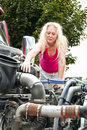 Blonde woman doing pretrip inspection Stock Photos