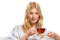 Blonde woman drinking a cup of tea Royalty Free Stock Image