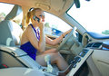 Blonde woman driving and talking to mobile phone Royalty Free Stock Photo
