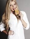 Blonde woman eating rabbit cookie
