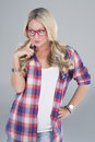 Blonde woman with eyeglasses a long hair plaid shirt and red a quirky smile Stock Photos