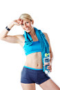 Blonde woman after fitness workout with water bottle and blue towel around her neck isolated on white Royalty Free Stock Photography