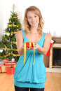 Blonde woman giving christmas present Stock Photos