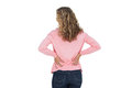 Blonde woman having a back ache and holding her back on white background Royalty Free Stock Photo