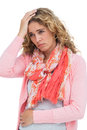 Blonde woman having both headache and belly pain on white background Royalty Free Stock Photo