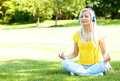 Blonde Woman with Headphone Meditating Outdoor Royalty Free Stock Photo