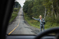 Blonde Woman Hitchhiking Royalty Free Stock Photo