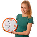 Blonde woman holding big clock in hand isolated over white. Royalty Free Stock Photo