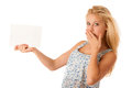 Blonde woman holding a blank white board in her hands for promotion nde promotional text or banner isolated over background Stock Photo