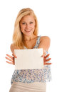 Blonde woman holding a blank white board in her hands for promotion promotional text or banner isolated over background Stock Image