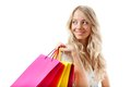 Blonde woman holding shopping bags Stock Photography