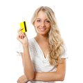 Blonde woman holding yellow credit card Royalty Free Stock Photography