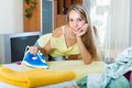 Blonde woman ironing at home Royalty Free Stock Photo