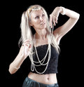 Blonde woman with long hair on dark background beautiful young and a pearl beads Stock Images