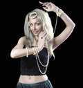 Blonde woman with long hair and a pearl dances an oriental dance Royalty Free Stock Photo