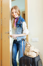 Blonde woman with luggage positive in home Royalty Free Stock Image