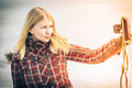 Blonde woman making self shot duck face on her vintage retro camera hipster lifestyle winter time Royalty Free Stock Images