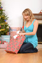 Blonde woman opening christmas present Royalty Free Stock Photo