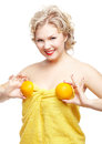 Blonde woman with orange Stock Images