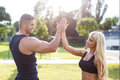 Blonde woman with personal trainer give high five