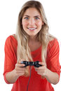 Blonde woman playing video games on a white background Royalty Free Stock Photography