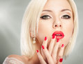 Blonde woman portrait with bright red lips and manicure Royalty Free Stock Photos