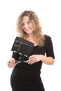 Blonde woman posing with clapperboard isolated on white Royalty Free Stock Image