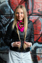 Blonde woman posing in front  grafitti Royalty Free Stock Photo