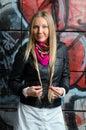 Blonde woman posing in front  grafitti Royalty Free Stock Photo