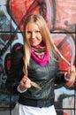 Blonde woman posing  of  grafitti Royalty Free Stock Images