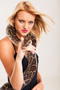 Blonde woman python Royalty Free Stock Images