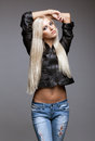 Blonde woman in ragged jeans and jacket Royalty Free Stock Photo