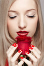 Blonde woman with rose Stock Photography