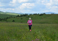 Blonde Woman Running on Meadow Royalty Free Stock Photo