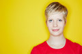 Blonde woman with short hair cut attractive young in front of yellow background Royalty Free Stock Photography