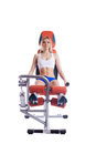 Blonde woman sitting on orange hydraulic exerciser Stock Images