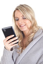Blonde woman with smartphone picture of a smiling a Stock Images