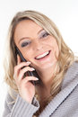 Blonde woman with smartphone picture of a smiling a Royalty Free Stock Image