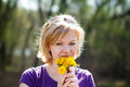 Blonde woman smell dandelion outdoors Stock Photos