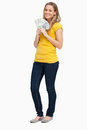 Blonde woman smiling while holding a lot of dollars Royalty Free Stock Photo