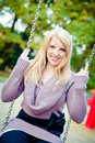 Blonde Woman on a Swing Stock Photos