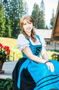 Blonde woman in traditional austrian clothes cheerful Stock Photo
