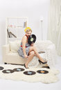 Blonde woman with vinyls Royalty Free Stock Images