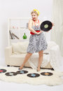 Blonde woman with vinyls Stock Photos