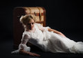 Blonde woman in a white dress with wooden chest Royalty Free Stock Image