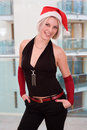 Blonde women with santa hat Royalty Free Stock Photos