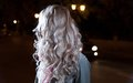 Blonde young girl waves of the hairs backside view no face this image has attached release Royalty Free Stock Photo
