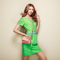 Blonde young woman in elegant green dress Royalty Free Stock Photo