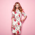 Blonde young woman in floral spring summer dress Royalty Free Stock Photo